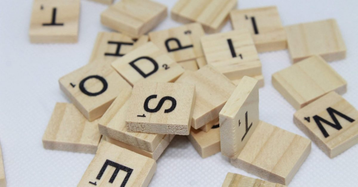 brown wooden letter blocks on white surface