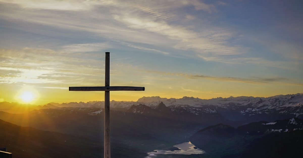 brown cross on mountain